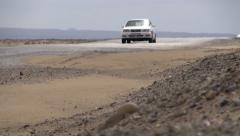 Turkmenistan desert, passenger car, transportation, Central Asia Stock Footage