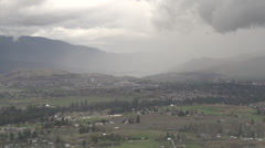 Time-lapse, inbound rain shower across valley floor Stock Footage