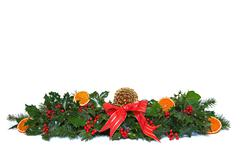 holly and dried orange christmas garland. - stock photo