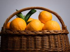 Orange basket Stock Photos