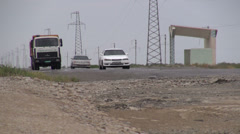 Turkmenistan desert, construction truck, old Soviet bus station Stock Footage