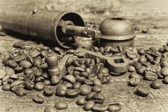 Stock Photo of coffee beans with coffee grinder on wooden table.