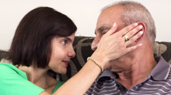 Happy old father and daughter hugging , looking at camera Stock Footage