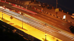 Night city road time lapse cars move leaving long traces Stock Footage