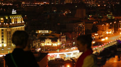 Night city sight seeing place, people gather watch urban scape Stock Footage