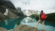 Stock Video Footage of Lake Moraine male viewing coniferous forests, Canada