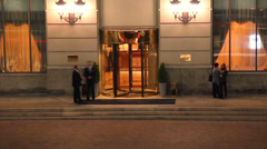 Elite 5-star hotel entrance at night timelapse visitors come out Stock Footage