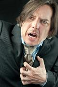 businessman experiencing a heart attack - stock photo