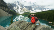 Stock Video Footage of Lake Moraine male viewing coniferous forests Rocky Mountains, Canada