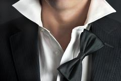man in tux relaxes - stock photo