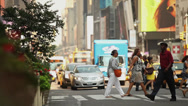 Stock Video Footage of Pedestrian Crossing Street in Times Square NYC