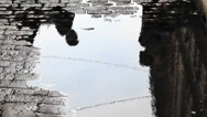 Stock Video Footage of Cobblestone Puddle Reflection in SOHO NYC