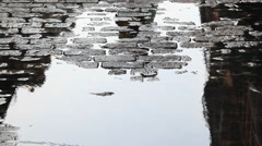 Puddle Reflection on Cobblestones in Soho NYC Stock Footage