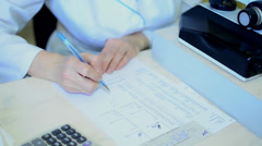 Doctor fills out a questionnaire - stock footage