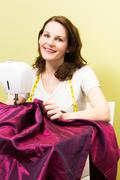 Brunette woman sewing Stock Photos
