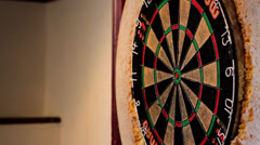 Darts Thrown at Dartboard - Close Up - stock footage