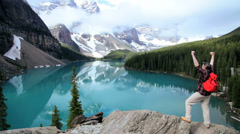 Male hiker success and achievement Lake Moraine Banff, Canada - stock footage