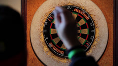 Darts Thrown at Dartboard - Over Shoulder POV Shot 2 Stock Footage