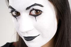 beautiful brunette woman theatrical close up mime dance white face - stock photo