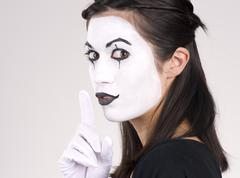 Beautiful brunette woman theatrical performance mime dance white face Stock Photos