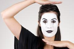 beautiful brunette woman theatrical performance mime dance white face - stock photo