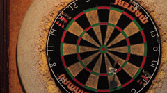 Darts Thrown at Dartboard - Over Shoulder POV Shot - stock footage