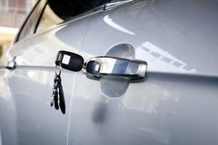 Forgotten car key on the door in parking lots Stock Photos