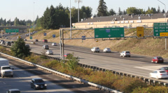 Freeway running both ways with Seattle sign in background Stock Footage