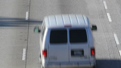 Following van up freeway to sign Stock Footage