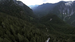 Aerial view extreme terrain valley forestation, Canada - stock footage