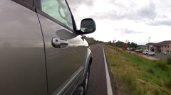 A car driving across countryside Stock Footage