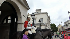 Tourists taking photo with horseguard London UK.(LONDON--HORSE GUARDS PARADE 1a) Stock Footage