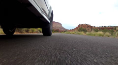 A car entering capitol reef national park Stock Footage