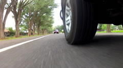 a car following another car on a road - stock footage