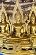 Seated buddha images in attitude of subduing mara with arch frame Stock Photos