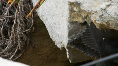 Close up broken concrete and re-bar Stock Footage