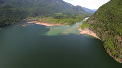 Aerial view mountain lake and river mouth forest wilderness Stock Footage