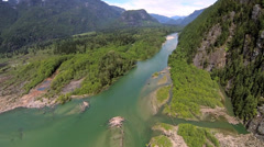 Aerial view mountain lake and river mouth forest wilderness - stock footage