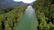 Stock Video Footage of Aerial view of conifer wilderness river remote area, USA