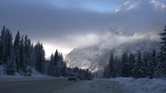 Winter travel on snowy highway, low clouds, nice light Stock Footage