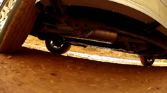 Beneath the car on a dirt road Stock Footage