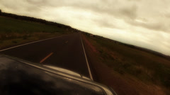 Car driving across countryside Stock Footage