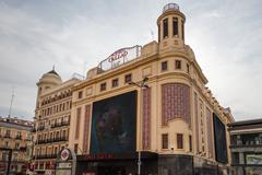 view of callao cinemas in gran via street, in madrid, spain - stock photo