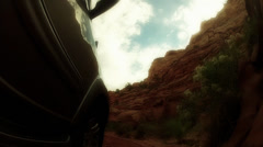 Driving by large desert cliffs in capitol reef Stock Footage