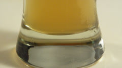 Tilt up of large glass of beer Stock Footage