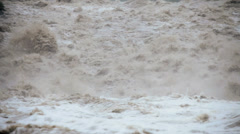 Fast flowing flooded river after rain storm, USA Stock Footage