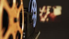 Film Projector plays old movie Stock Footage