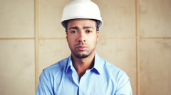 Serious engineer portrait on building site Stock Footage
