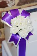 white flowers and purple ribbon - stock photo