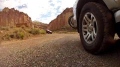 Shot of wheels on desert road Stock Footage